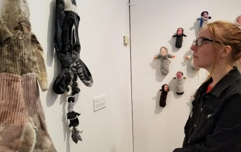 "Psychology major Tayler Meulpolder takes a look at Katie Richardson's 2016 piece ""Rabbit Skin Rug"" in the ""Messages: Material Matters"" exhibit in the Eddie Rhodes Gallery in A-5 on Monday."