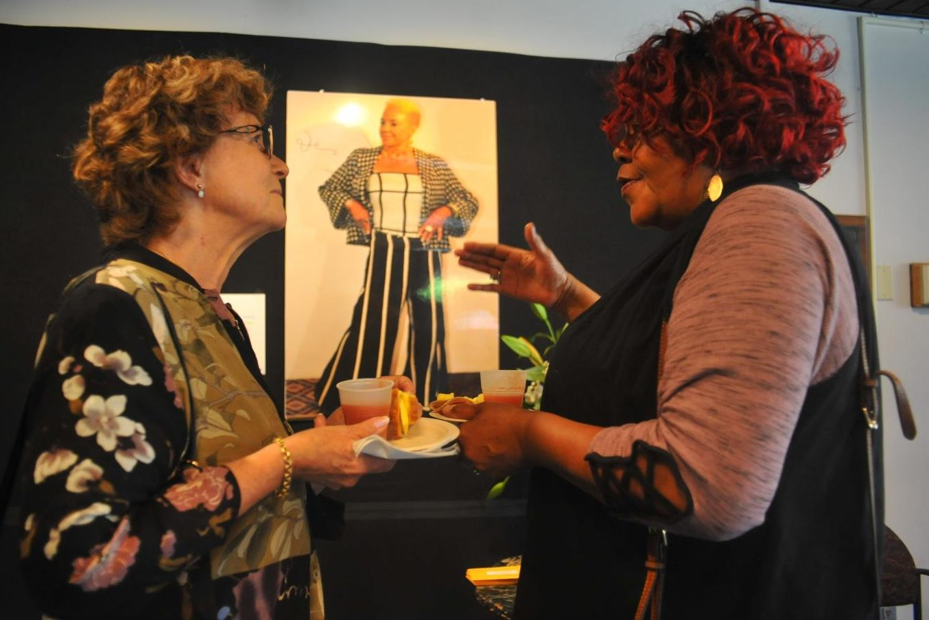 Barbara Grillo (left) and Richmond resident Wendy Mouton (right) talk about Intisar Shareef after her memorial service at the Knox Center.