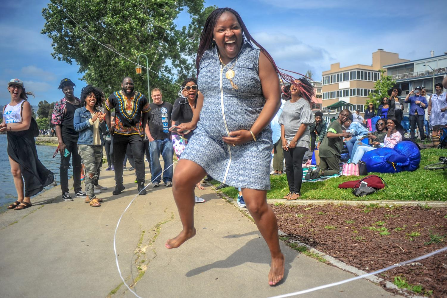 Oakland resident Thoineisha Finley doubledutch jumps while pregnant during the