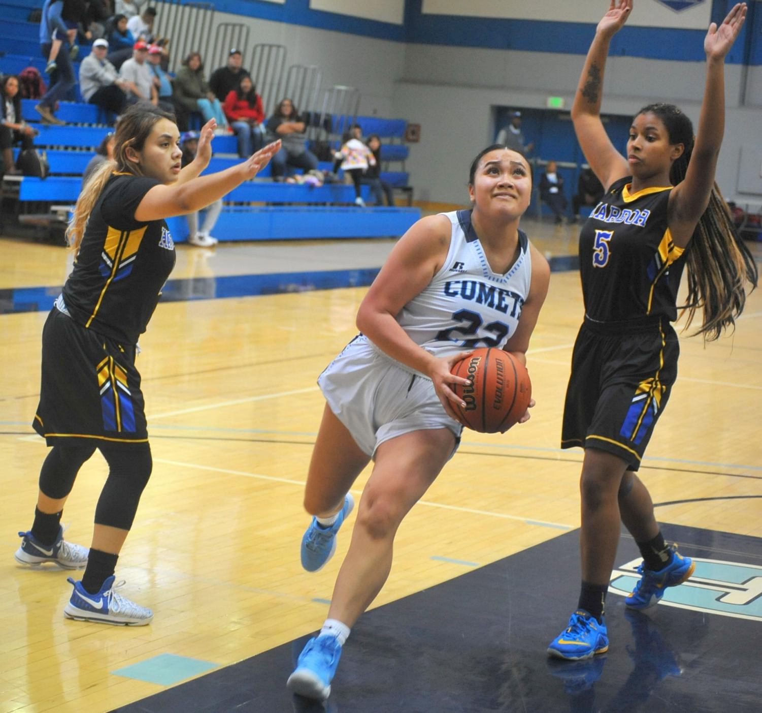 Jahna Maramba drives to the basket during a basketball game in the gymnasium