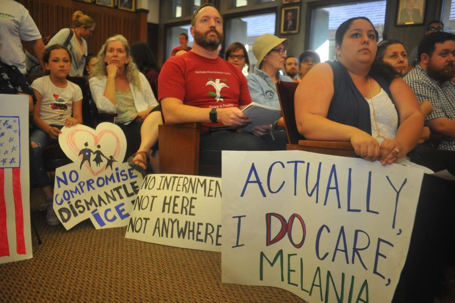 Protesters listen to a speaker during the Concord City Hall on June 26 in Concord, California. Protesters gathered after a leaked memo detailed plans to build an undocumented immigration detention center in the Concord Naval Base.