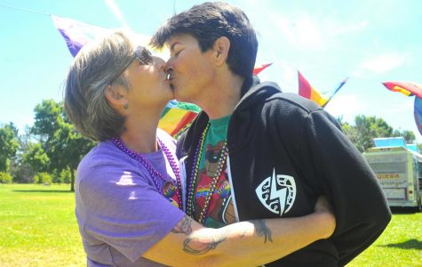 Richmond residents Simone (left) and Alyssia Adair (right) kiss during the fourth annual Richmond Rainbow Pride event in Richmond Marina Park in Richmond, California on June 3.