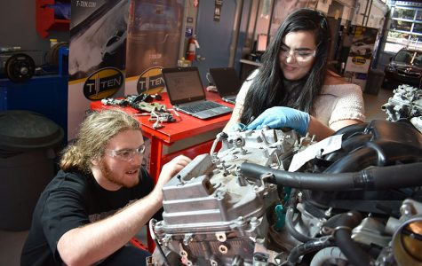 Automotive students Craig Yano and Mariah Henry work together to take apart a V6 Toyota engine in the Automotive Technology Building on Thursday. A number of engines were given to the automotive department by Toyota as part of the upcoming T-Ten program.