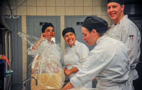Team Dilly Dilly celebrate their win in the kitchen of Aqua Terra Grill during the Culinary Clash on Sept. 6