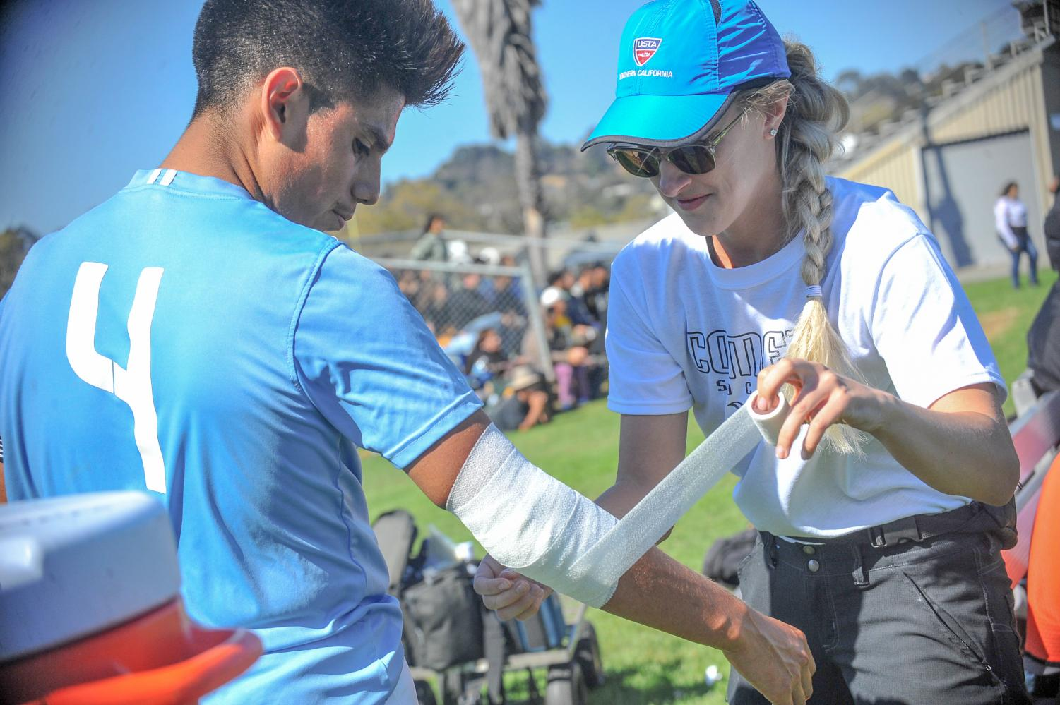 New athletic trainer Nichole Oaks wraps a bandage around Comet men's soccer team defender Raul Garcia's arm during a home game on Friday against College of the Redwoods.