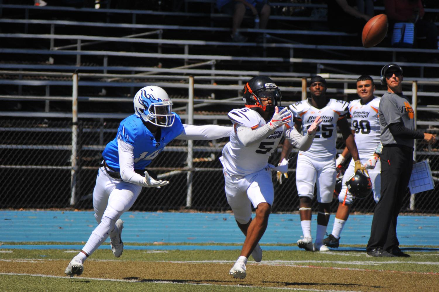 Reedley College Tiger cornerback James C. Day (right) intercepts Comet quarterback Jalen Tregle as wide receiver Kyree Jackson (left) looks on during Contra Costa College's 50-20 loss on Saturday.