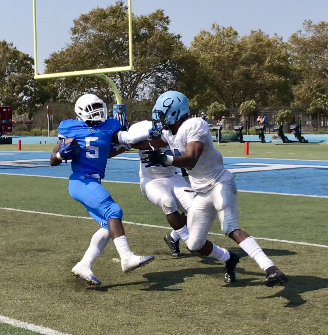Comet running-back Maurell Robinson does a spin move on two Mustang defenders to give Contra Costa their  only score during their 38-6 loss last Saturday at Comet Stadium.