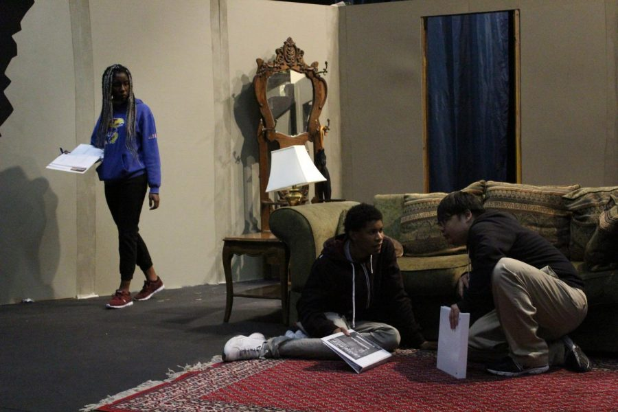 "Joshua Saephan (right) and Murphy Williams (middle) attempt to hide from Merit Onyekwere (left) during rehearsal for ""Vengeance: A Ghost Story"" in the Knox Center on Monday."