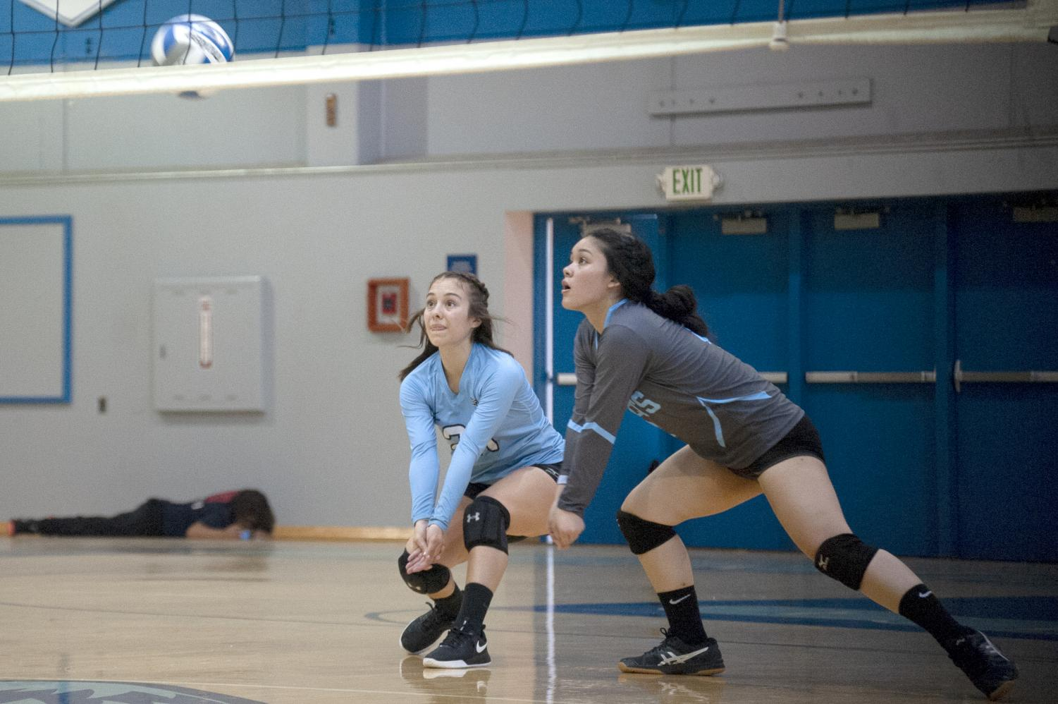 Libero Delanie Baca (left) and outside hitter Chrischelle Reyes (right) anticipate a ball during Contra Costa College's 3-0 defeat against College of Marin on Friday at the Gym.