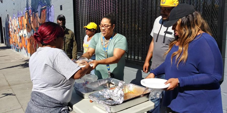Contra+Costa+College+sociology+major+Jessica+Breaux+%28right%29+hands+out+donated+food+to+those+in+need+at+the+corner+of+23rd+and+West+Grand+Street+in+Oakland%2C+California%2C+on+Saturday.