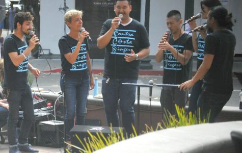 JAZZ-ology sings during a fundraising event in front of Peet's Coffee on 4th Street in Berkeley on Saturday. The group is fundraising toward new sound equipment, funds for department trip expenses and ts yearly CD production.