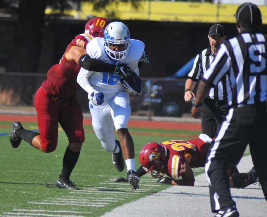 Comet wide receiver Terique Owens sheds two Mustang defenders during Saturday's 41-6 victory over Los Medanos College in Pittsburg. The win ended CCC's 17-game losing streak.