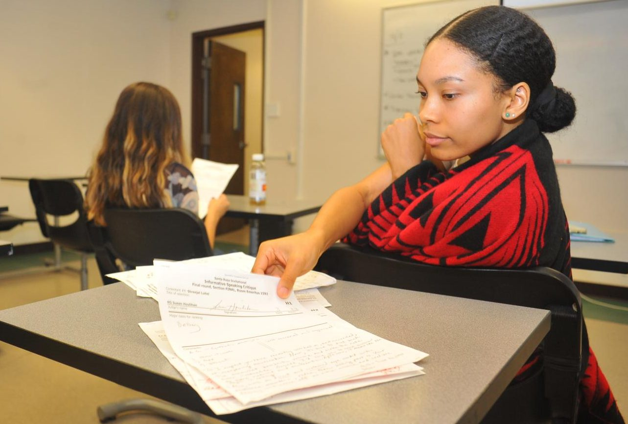 Speech team member Sydnie Alex reviews ballots from the 50th Annual Santa Rosa Junior College Speech and Debate Tournament during speech team practice on Thursday.