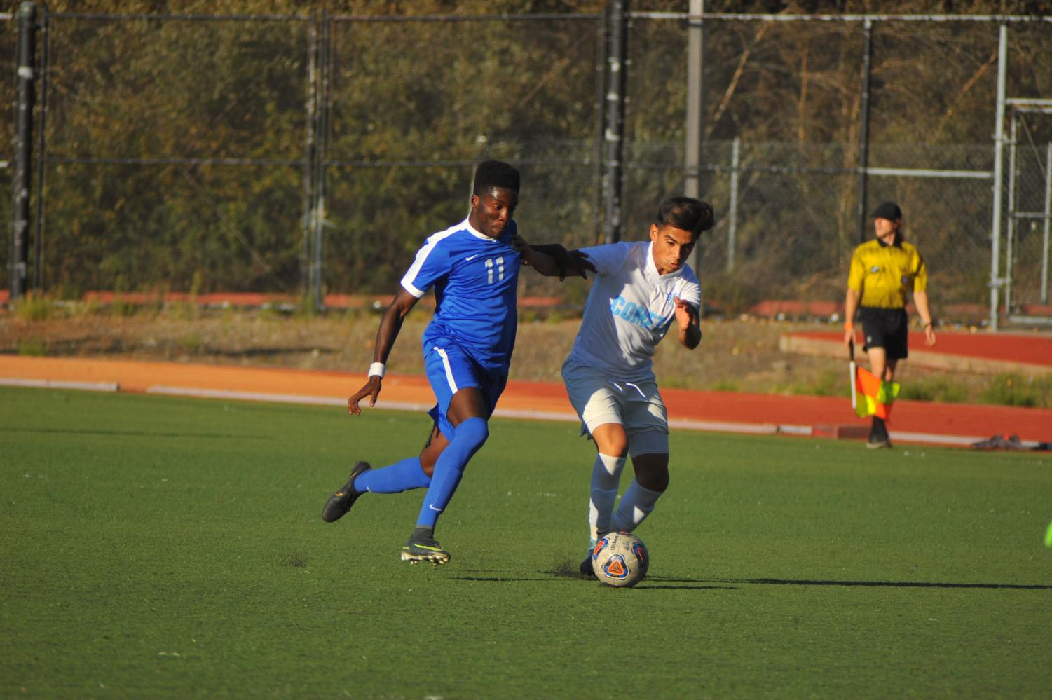 Comet defender Raul Garcia (right) loses possession of the ball to Thunderbird midfielder Haruna Mubarak resulting in the game's lone score Friday in Oakland.