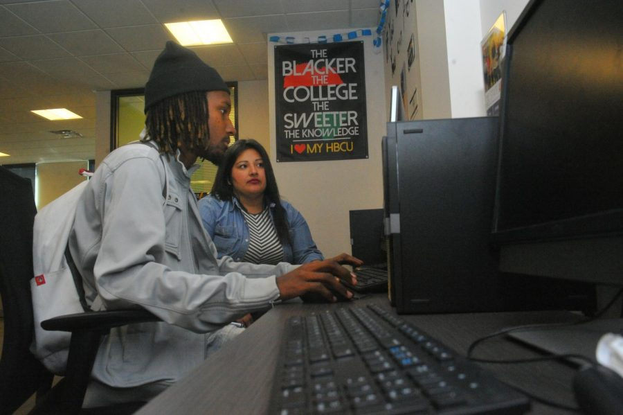 Students in the Career/Transfer Center fill out their four-year college applications last week.