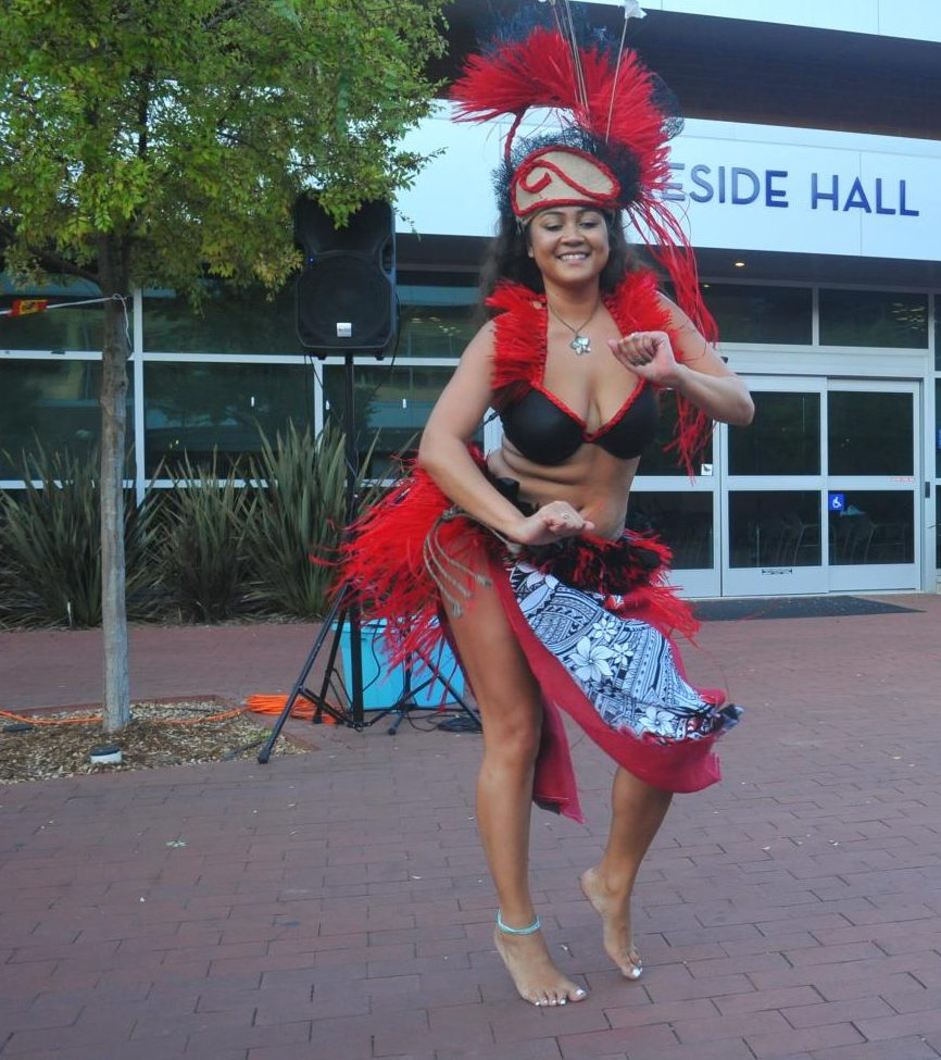 Polynesian dancer Raven Mapanal dances Hitoto Otea outside of Fireside Hall during DACAWeek's Multicultural Night on Wednesday.
