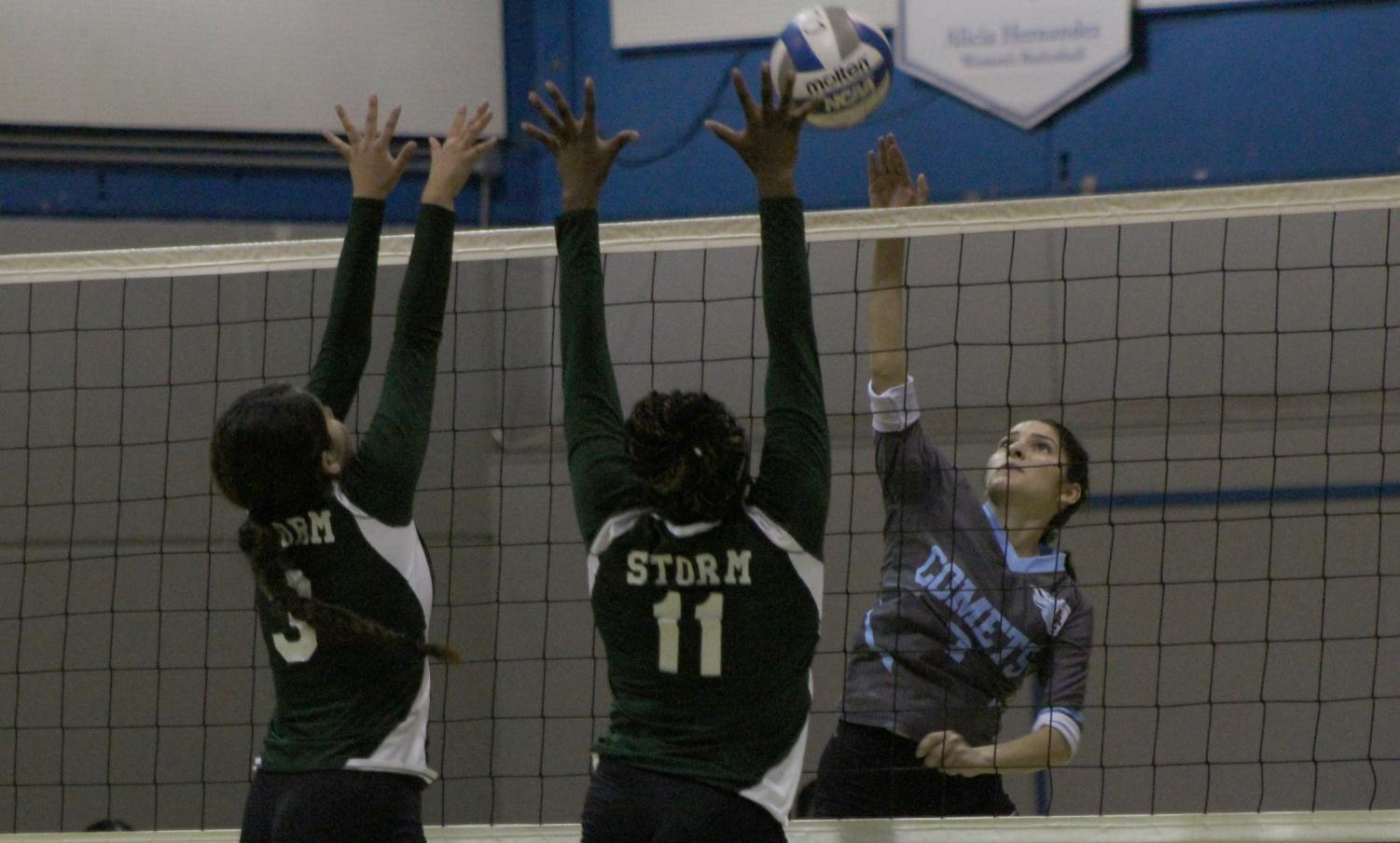 Right setter Rosa Olivar attempts to score over Napa Valley College middle blocker Alexia Stewart in Contra Costa College's 3-0 victory in the Gymnasium on Friday.