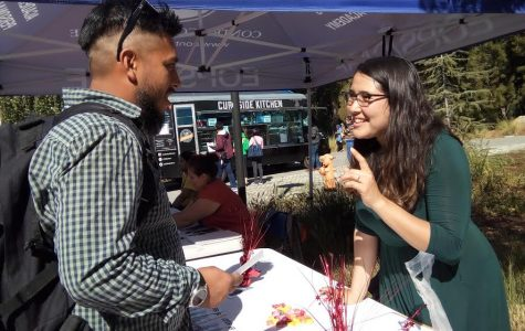 Student activist Marisol Grace (right) talks to a student during the You've Got a Friend in Me Undocumented Resource Fair in the Campus Center Plaza on Oct. 16