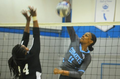 Twins serve it up on volleyball court