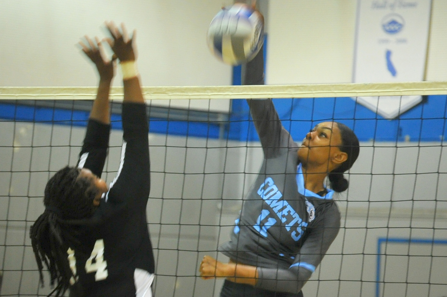 Middle blocker Makaya Thomas spikes the ball during a volleyball game this season