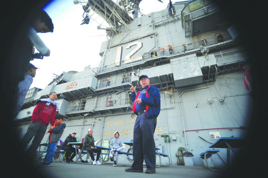 USS+Hornet+Museum+tour+guide+Sydney+Kennedy+gives+a+tour+of+the+flight+deck+to+a+group+on+Veterans+Day+Sunday.+The+USS+Hornet+Museum+celebrated+the+100th+year+since+the+Armistice+Treaty+ending+WWI+was+signed.+