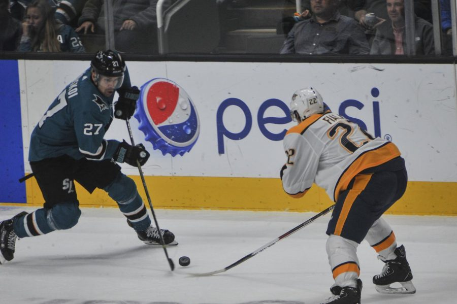 Joonas Donskoi (left) jukes Kevin Fiala (right) during the San Jose Sharks vs. Nashville Predators game on Tuesday.