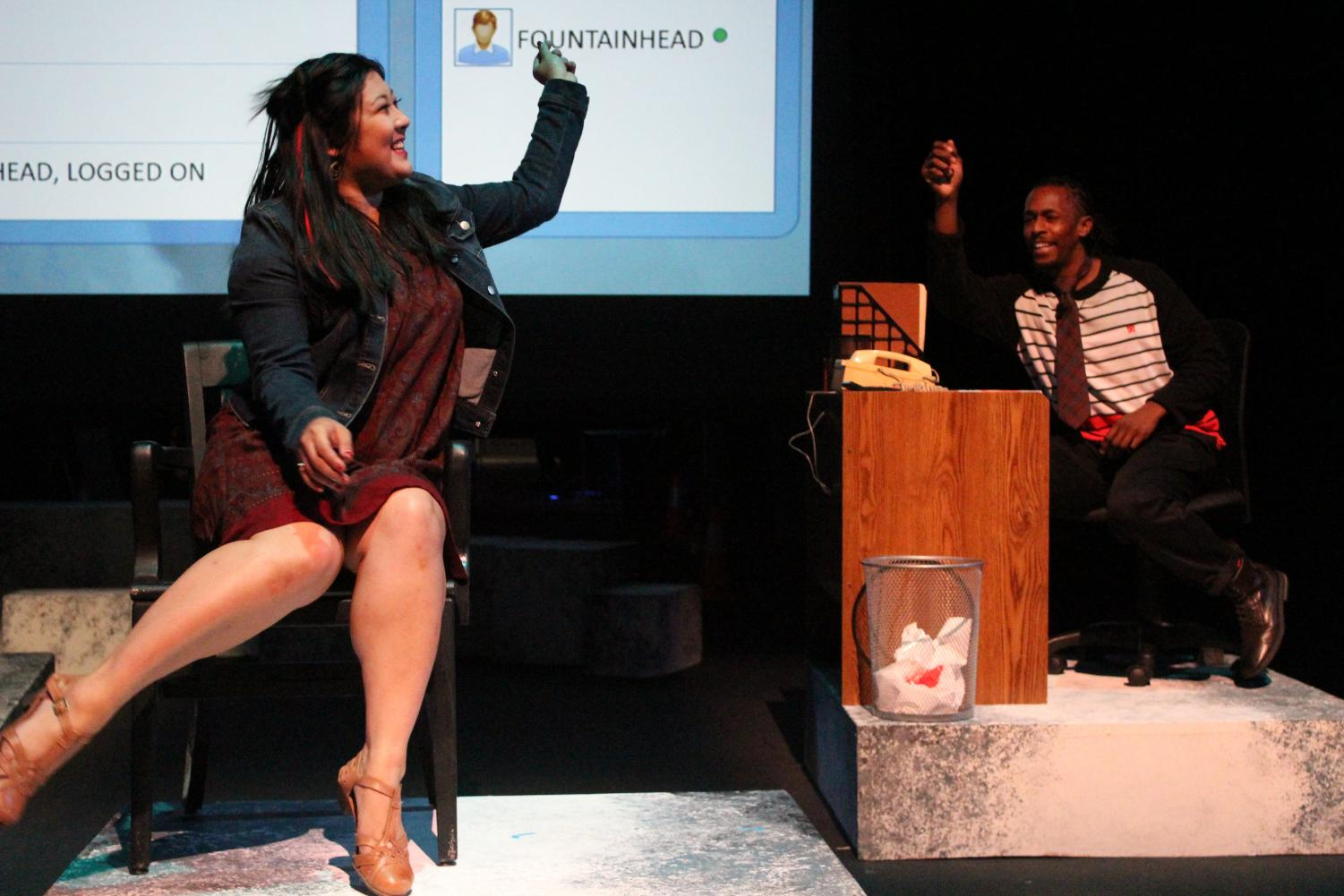 "Orangutan (left), played by Anne Yumi Kobori, interacts with Chutes&Ladders, played by Umi Grant, in an online addiction recovery chat room in ""Water by the Spoonful"" at a rehearsal in the Knox Center on Monday."
