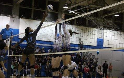 Middle blocker Makaya Thomas makes a shot attempt over two Yuba College defenders on Sophomore Night in the Gymnasium