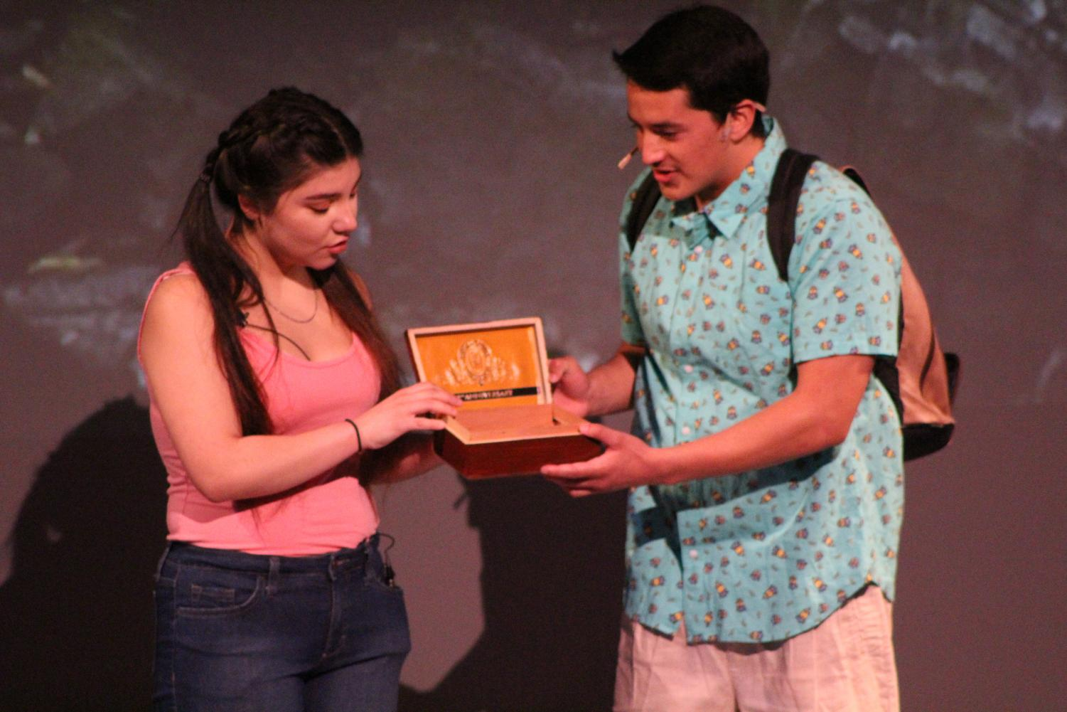 "Yaz, played by Melissa Velasquez, and Elliot, played by Diego Loza, throw the ashes of their deceased mother into a waterfall during a scene in ""Water by the Spoonful"" in the Knox Center on Thursday."