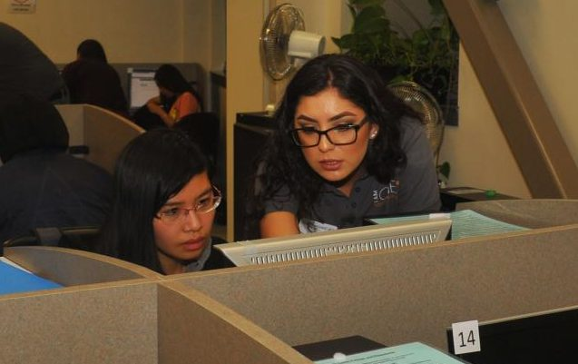 Financial Aid Supervisor Monica Rodriguez (right) helps a student fill out an application for financial aid during the Cash for College workshop at the Career/Transfer Center.