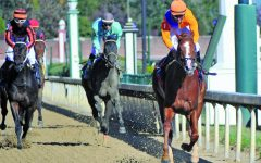 Horses, jockeys compete at Churchill Downs