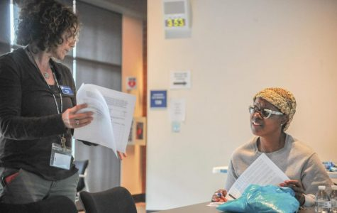 EOPS counselor Julie Skoler (left) helps a student during a compressed calendar informational session workshop at Fireside Hall at the end of the 2017 spring semester.