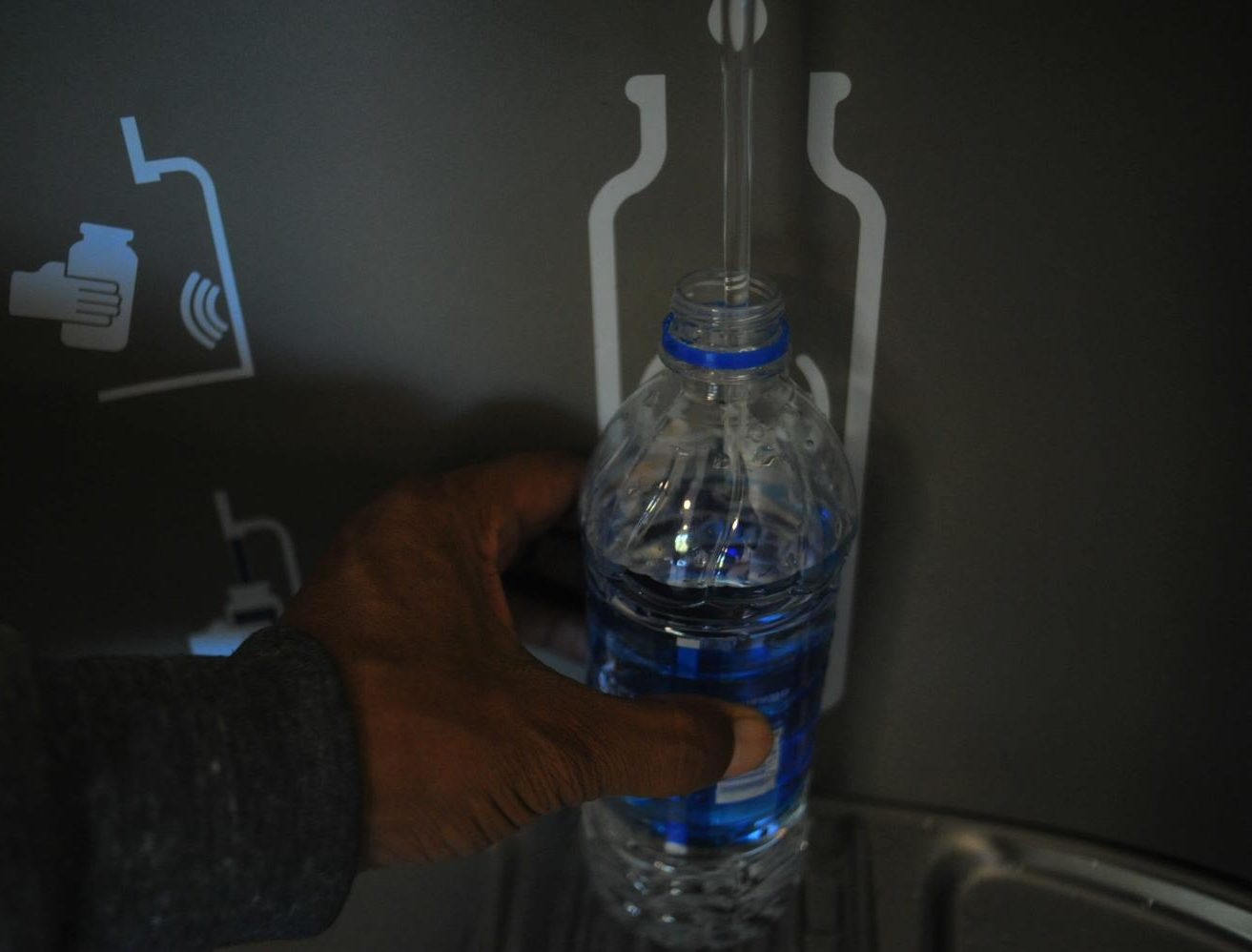 The automated water fountain systems, such as this one in the GE Building, need their filters changed regularly. If the water fountain has a red light under the filter status, it means the filter needs to be changed.