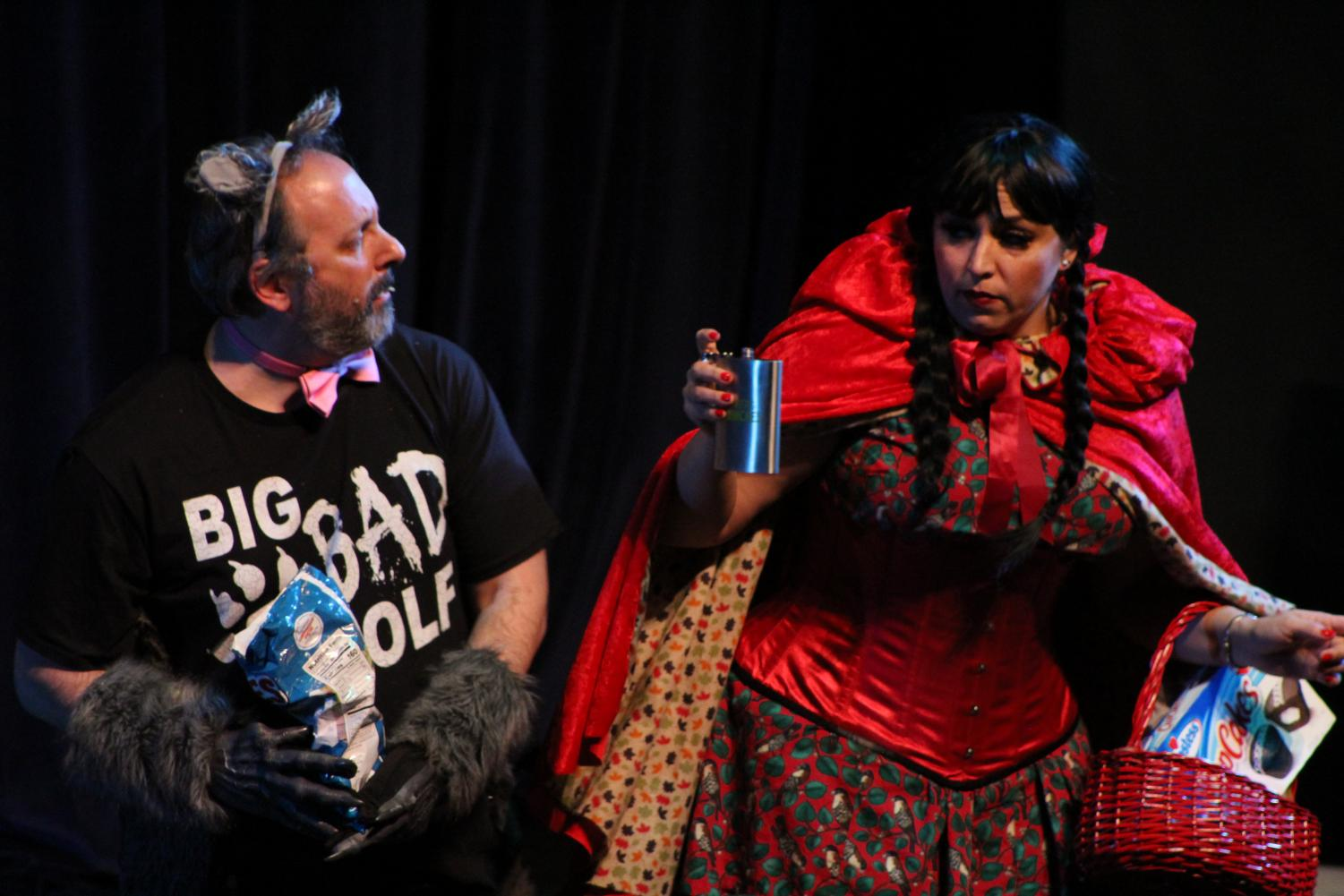Liberal arts Dean Jason Berner (left) as the Big Bad Wolf is offered alcohol by Little Red Riding Hood played by Theater Staging Specialist Courtney Johnson during