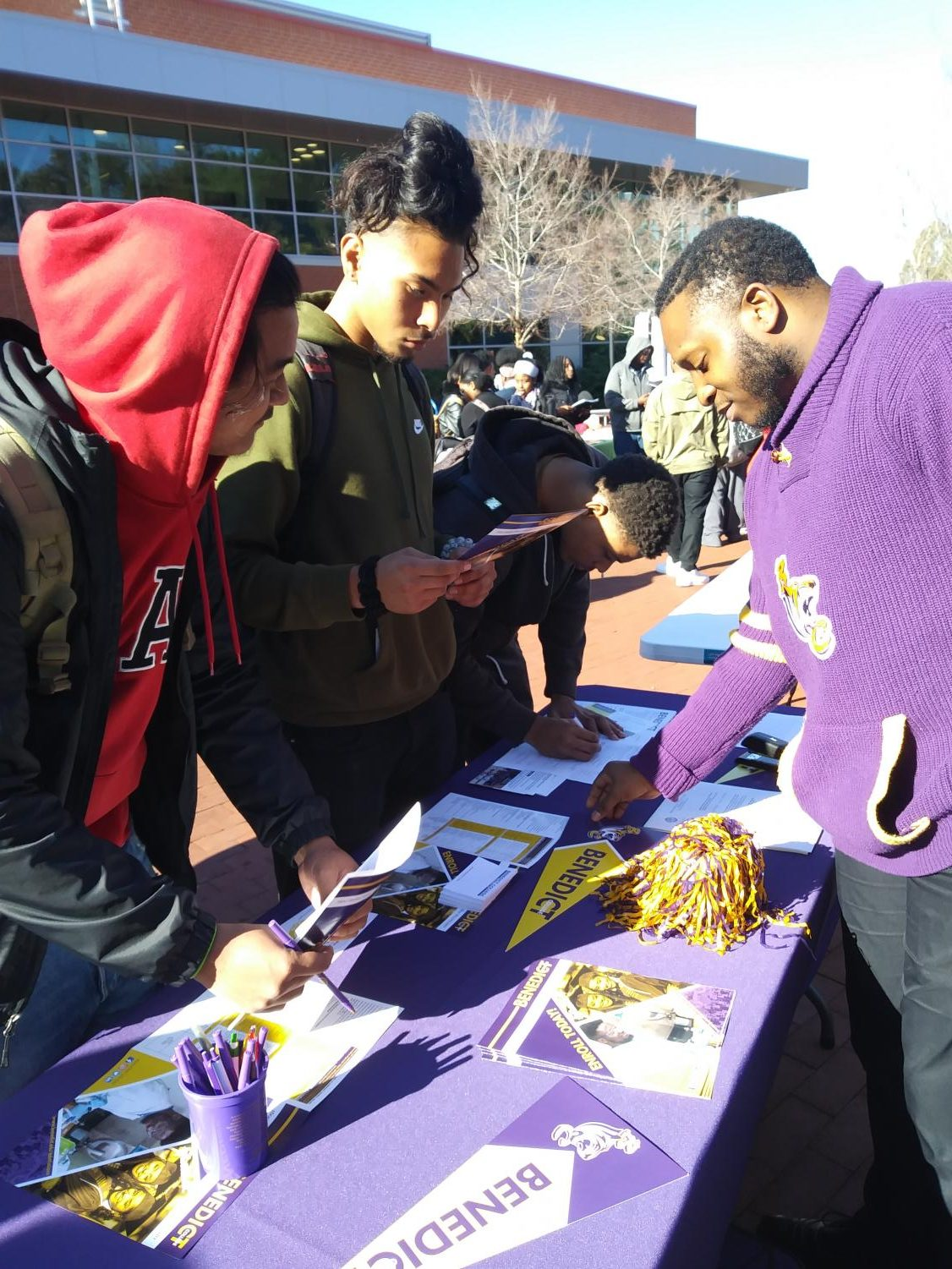 Two students discuss the application and transfer process with Benedict College representative during the HBCU Caravan at the Campus Center Plaza on Feb. 6.