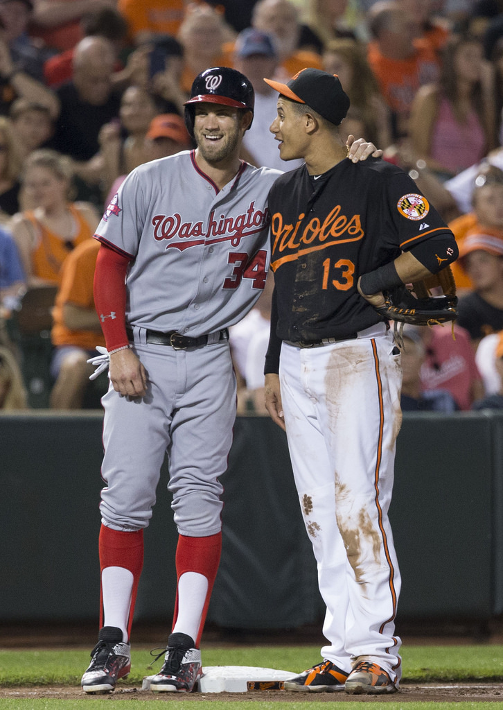 Free agents Bryce Harper and Manny Machado remain free agents as spring training is set to begin.