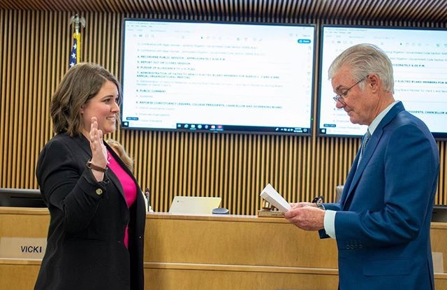 Rebecca Barrett gets sworn in as Governing Board Trustee of Ward III during the Dec. 12 Governing Board meeting.