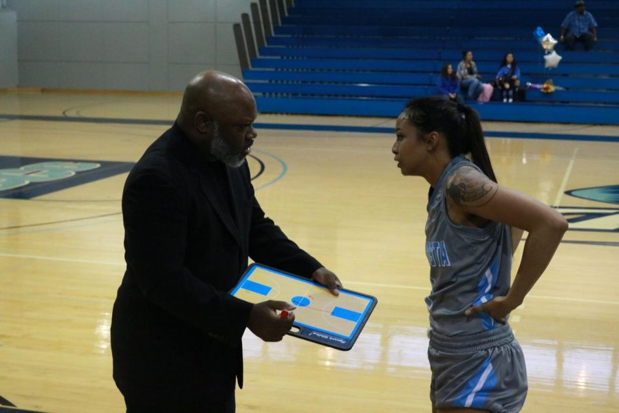 Contra Costa College women's head coach Vince Shaw talks to Comet guard Janelle Pansoy during CCC's 64-57 loss to Yuba College on Feb. 20 in the Gym. Shaw started his CCC career in 2016 and hopes to establish a program that benefits the community that seek it.