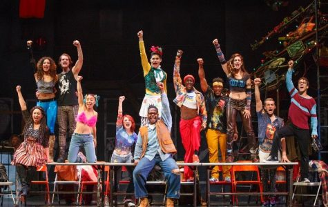 "Cast members of Fox's ""Rent"" live raise their fists in solidarity for those dying from AIDS during the musical number ""La Vie Boheme."""