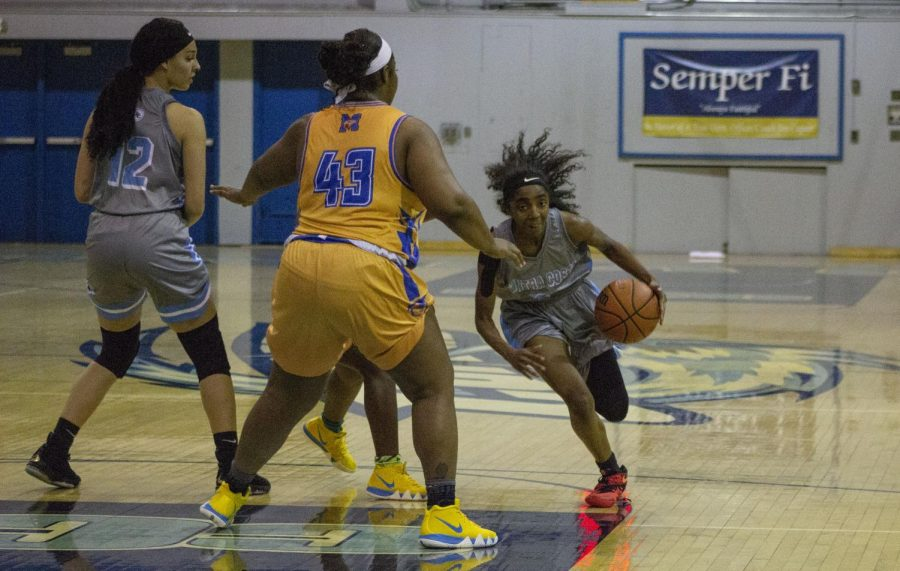Comet guard Sicaly Sorrell drives down the lane in last week's 62-60 defeat against Merritt College in the Gymnasium.