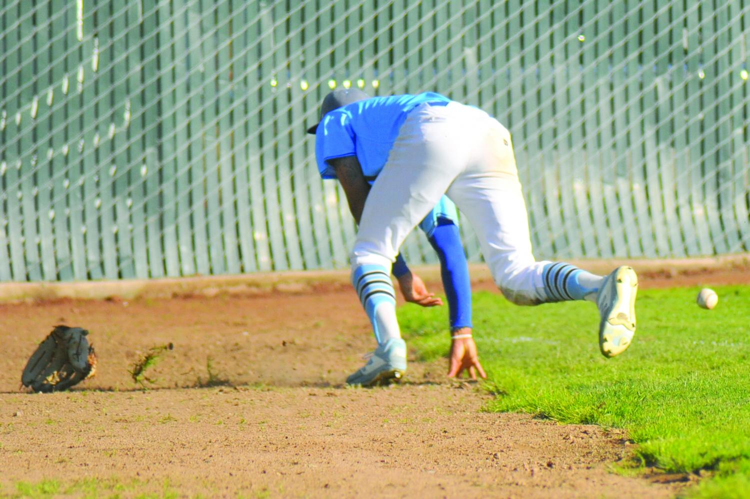 Outfielder Mychael Jamison   loses his glove after he dove and missed the ball in the ninth inning   during Contra Costa College's 1-10  loss against Solano Community College on  March 14 at the Baseball Field.