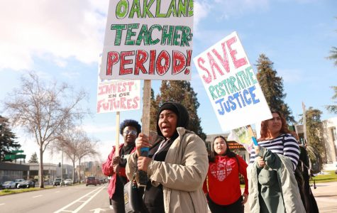 Oakland Technical  High School  Junior  Kalanie Scott  (middle forefront), Oakland Tech junior Jordan Green (left),  and Oakland  Tech junior Aidaly  Matancillas  (right) protest outside  Oakland Tech on Feb. 25.