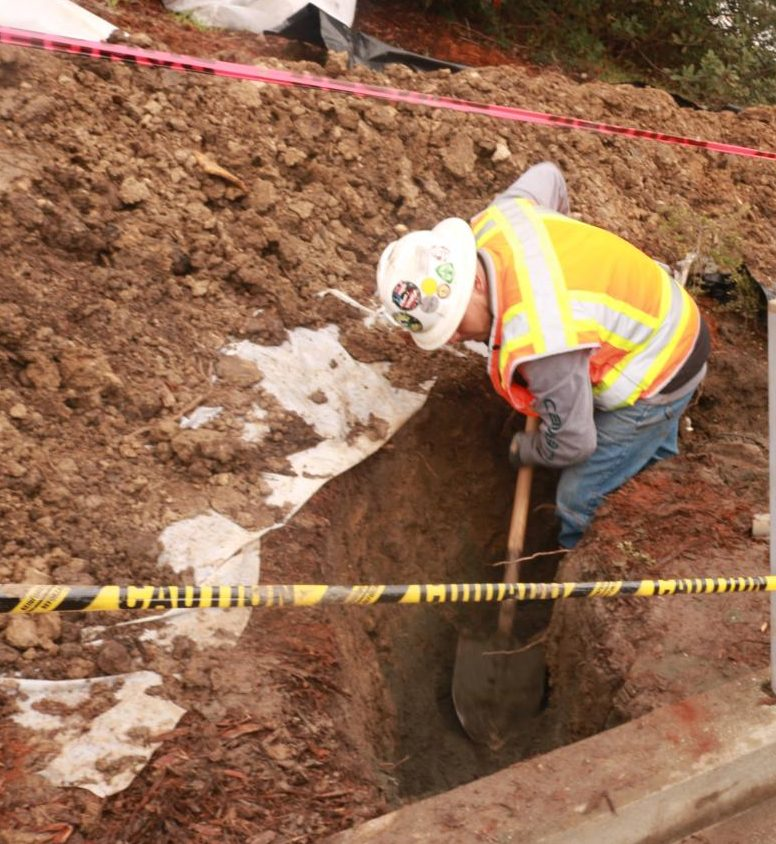 Contractor Sylvester Duarte digs near the Applied Arts Building as part of the campus construction for the new Science Complex