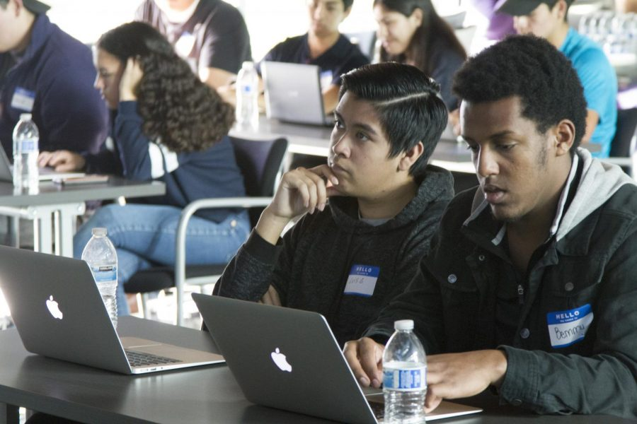 Students+take+notes+while+listening+to+a+presenter+at+one+of+the+free+coding+events+organized+by+richmondCodes.+