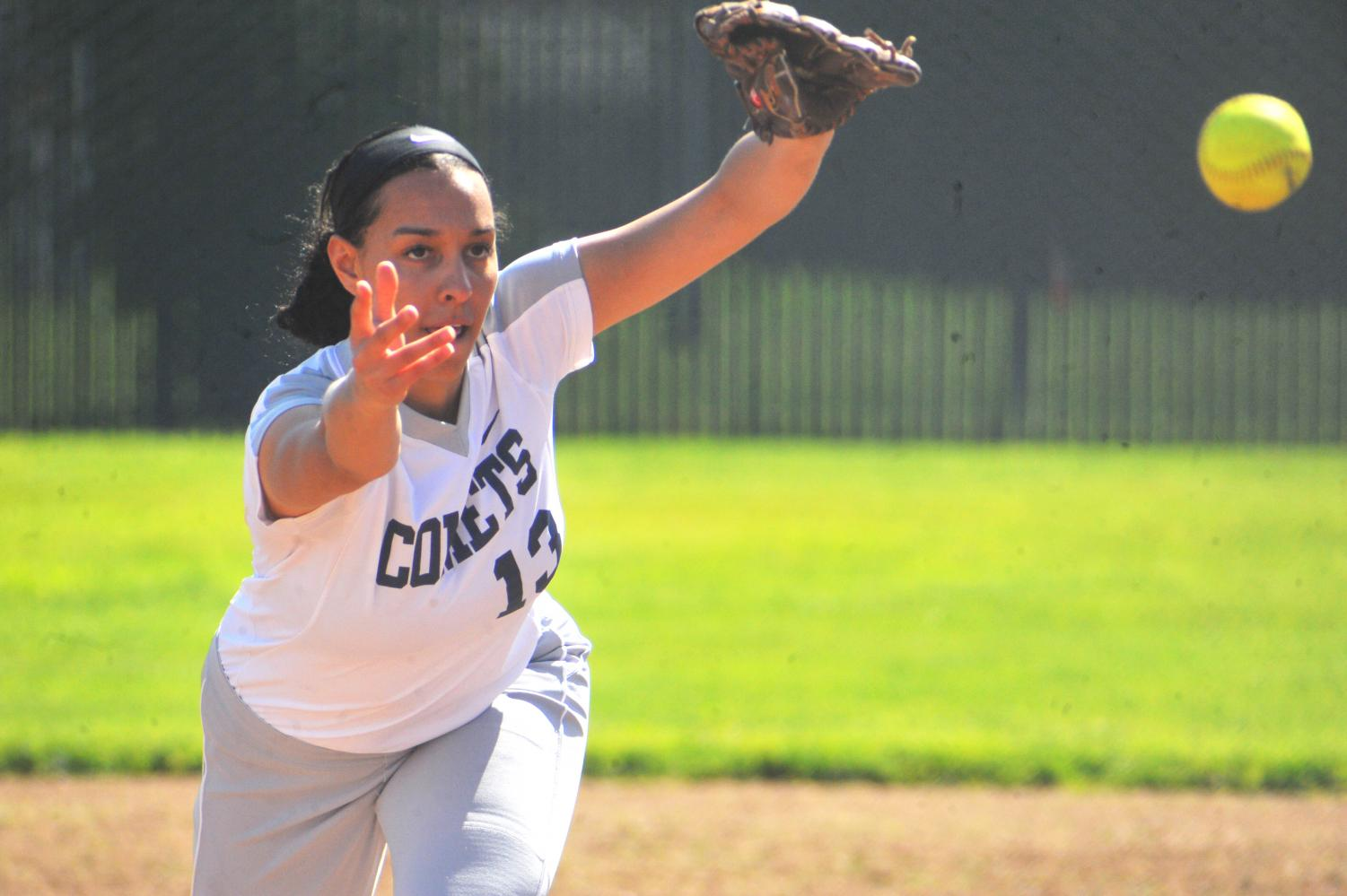 Comet pitcher Larissa Carvalho launches a pitch during the top of the fourth inning in Thursday's 15-2 loss against Yuba College at the Softball Field.