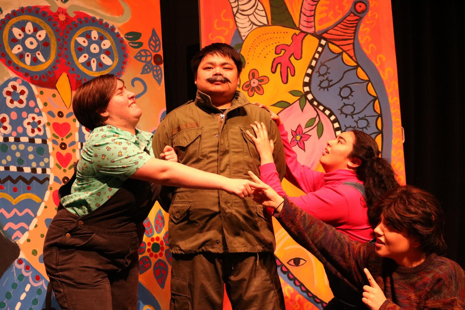 """Joshua Saephan (second from left), who plays Fidel Castro, is questioned by Sydney Smith (left), Jelaine Maestas (second from right) and Melissa Velasquez (right) in a skit during a dress rehearsal of """"The Hispanick Zone"""" on Monday."""