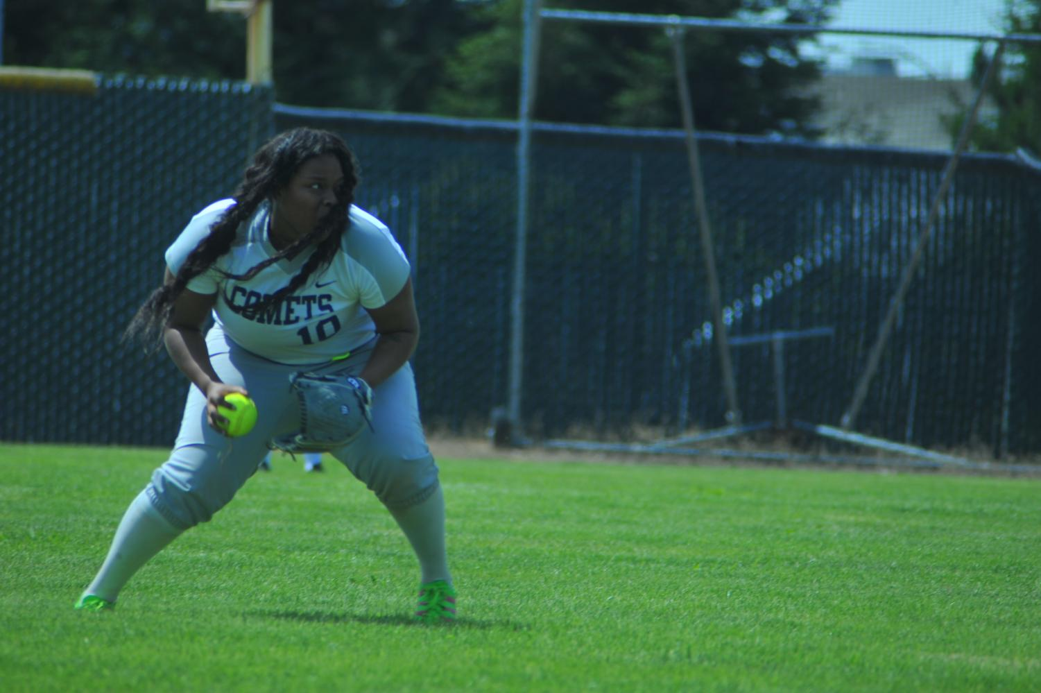 Comet infielder Brianna Williams picks up a pop up and gets ready to throw it  during Contra Costa College's 21-2 loss against Mendocino College on April 19.