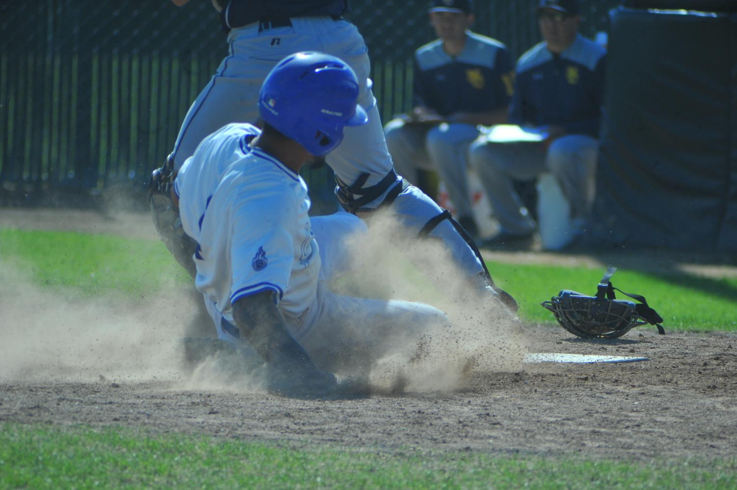 Comet second baseman Bryan Perez slides into home and was tagged out during Contra Costa College's 5-4 win against Mendocino College at Comet Baseball Field on April 19.