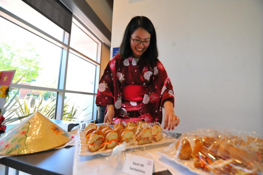 Chemistry major Elissa Lee serves Vietnamese sandwiches as part of the international food event in Fireside Hall April 24. The event featured foods from countries like Korea, Japan, China and Mexico.