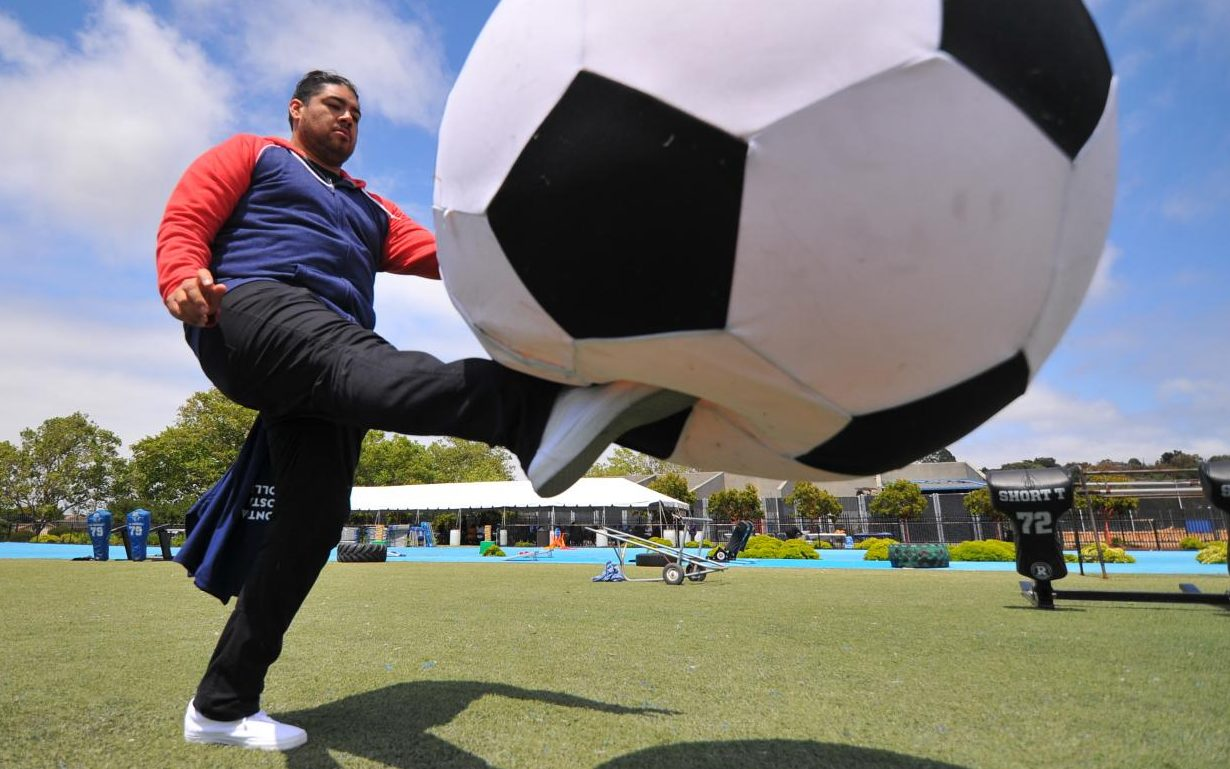 "Student Life Coordinator Charles Ramirez juggles an oversized soccer ball during the a faculty development event, ""Picnic Day"" in the Comet Stadium on Thursday."